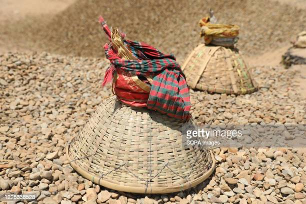 Laborers' baskets. Laborers carry around 7,000kg every day and earn Tk500-600 on average daily. Daily laborers wake up at the crack of dawn and rush...