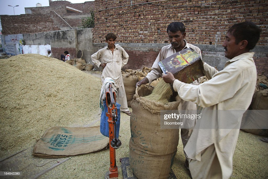 Laborers fill bags with rice at a rice market in the Chiniot district of Punjab province, Pakistan, on Saturday, Oct. 13, 2012. Rice exports from Pakistan, the fourth-largest shipper, are set to rebound from November with the new harvest after a rally in domestic prices and cheaper supplies from India cut shipments, a traders' group said. Photographer: Asad Zaidi/Bloomberg via Getty Images