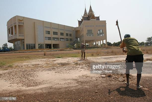 Laborers lay telecommunication cables for a new modern courthouse in Phnom Penh Cambodia site of the upcoming Khmer Rouge tribunal