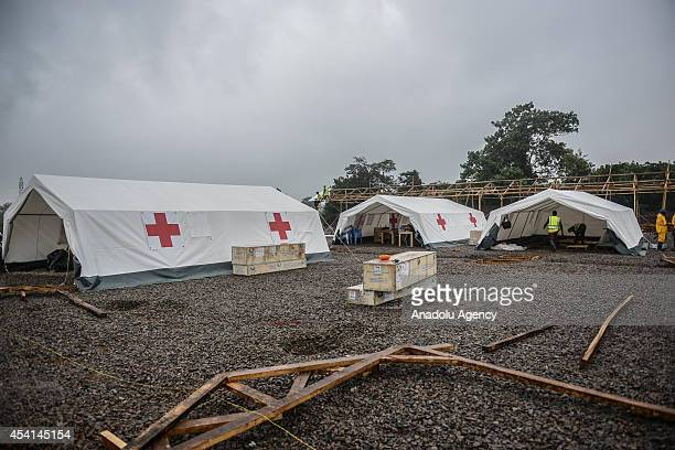 Laborers of International Committee of the Red Cross work on the construction a brand new health center in Kenema Sierra Leone on August 25 2014...