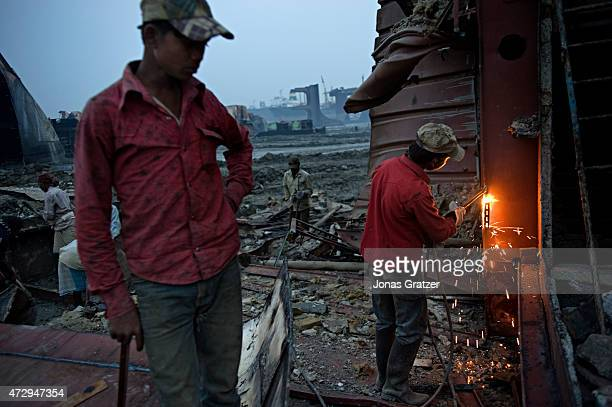 Laborers on Chittagong beach disassemble a mega freighter that has been abandoned to be scrapped for its metal. Where do the mega freighters and...