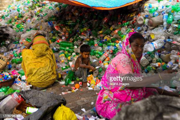 Laborers seen working at a plastic bottle recycling factory in Dhaka.