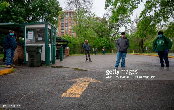 Laborers wait in a parking lot for day jobs in Arlington Virginia on May 6 during the COVID19 pandemic The April US employment report due out May 8...