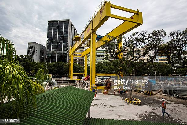Laborers work above ground during the construction of the Nossa Senhora da Paz metro station on the 4 Line of the subway system in Rio de Janeiro...