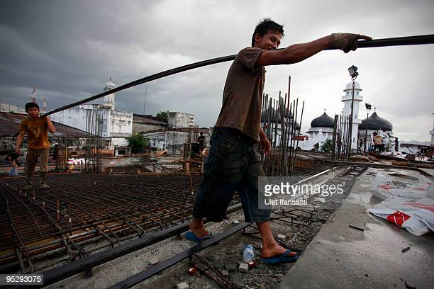 Laborers work at a construction site near Baiturrahman mosque on the fifth anniversary of the 2004 Boxing Day earthquake and subsequent tsunami on...