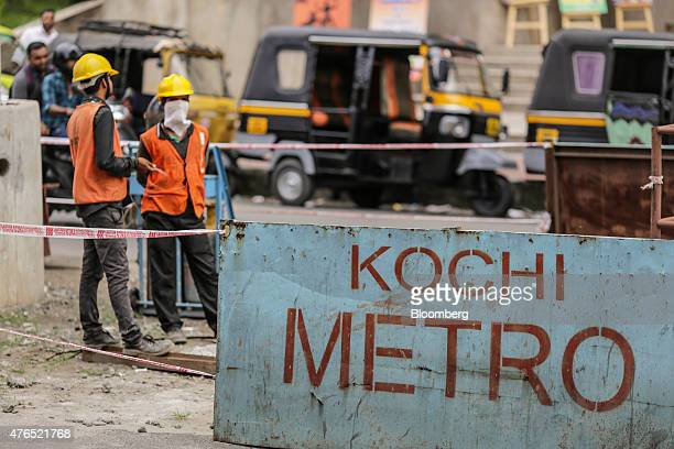 Laborers work at a Kochi Metro construction site in Cochin India on Thursday May 28 2015 Prime Minister Narendra Modi is counting on a revival in...