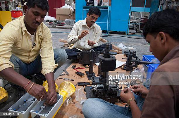 Laborers work at Pari Precision Automation and Robotics India July 18 2011 in Pune India The company manufactures automated assembly lines for Ford...