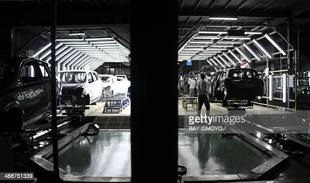 Laborers work at the new Nissan plant in Purwakarta West Java province on May 8 2014 According to Nissan the inauguration of its newest Nissan...