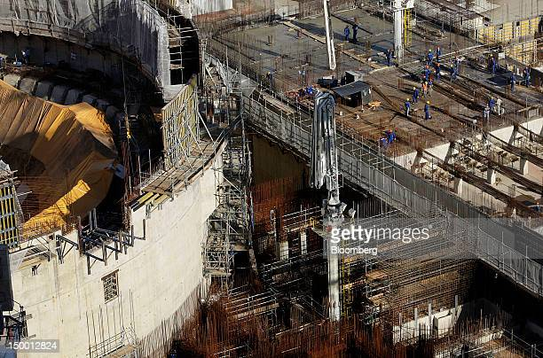Laborers work on the construction of Angra Nuclear Power Plant's third reactor Angra III in Angra dos Reis Brazil on Tuesday Aug 7 2012 Construction...