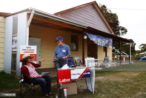 Labour and Liberal party representatives chat outside a polling booth in the electorate of Hume on election day on September 7 2013 in Tallong...