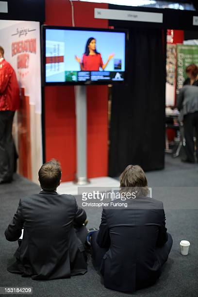 Labour delegates watch Shadow housing minister Caroline Flint on a television screen during the Labour Party Conference at Manchester Central on...