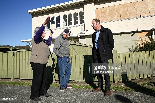 Labour Leader Andrew Little speaks to members of the public outside an empty state house on July 16 2016 in Lower Hutt New Zealand Rising property...