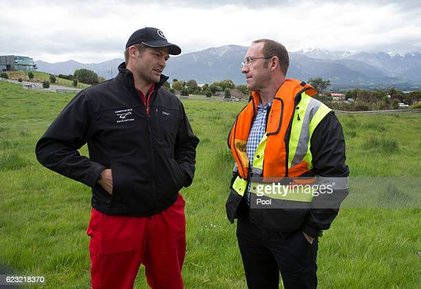 Labour leader Andrew Little talks with helicopter pilot Richie McCaw during his visit to Kaikoura on November 14 2016 in New Zealand The 75 magnitude...