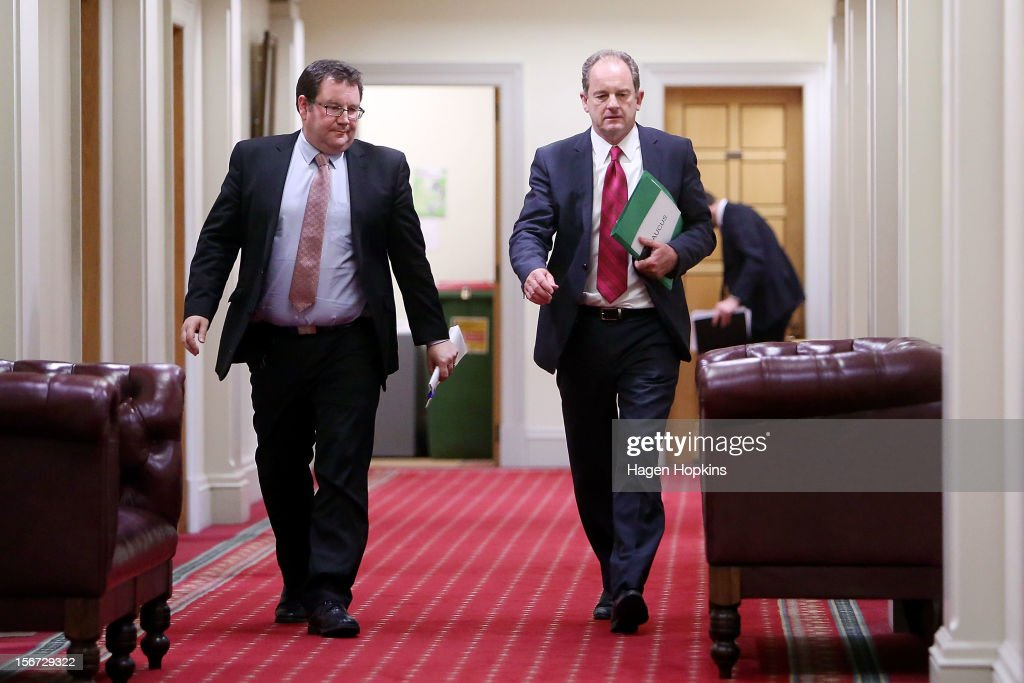 Labour leader David Shearer (R) and deputy leader Grant Robertson emerge from the caucus room at Parliament on November 20, 2012 in Wellington, New Zealand. Labour party members were called to a leadership vote meeting today after speculation of a leadership challenge by economic development spokesman David Cunliffe.