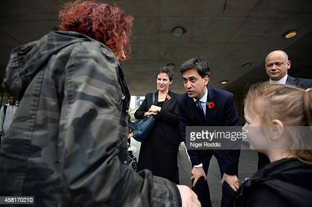 Labour leader Ed Miliband and Shadow Transport Secretery Mary Creagh speak to members of the public on their way to a meeting with UK council leaders...