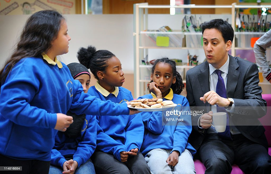 Labour leader Ed Miliband meets school children during a visit to the Michael Faraday School on May 23, 2011 in Southwark, south east London. Mr Miliband, who is due to marry his partner in four days' time, spoke at the Royal Festival Hall said that Prime Minister Cameron's claim to be helping young people is being 'blown apart' by the coalition's current policies.