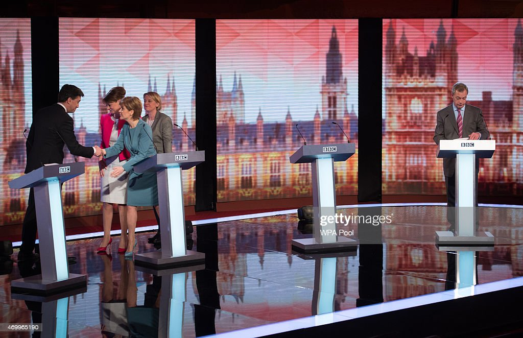 Labour leader Ed Miliband (L), shakes hands with SNP leader Nicola Sturgeon whilst Plaid Cymru leader Leanne Wood and Green Party Leader Natalie Bennett (C) look on and UKIP leader Nigel Farage gathers his notes take after they all took part in the Live BBC Election Debate 2015 at Central Hall Westminster on April 16, 2015 in London, England. The leaders of five political parties are taking part in the election debate, without Prime Minister David Cameron and Deputy Prime Minister Nick Clegg. Britain goes to the polls in the General Election on May 7.