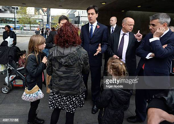 Labour leader Ed Miliband speaks to members of the public on his way to a meeting with UK council leaders at the Town Hall on October 31 2014 in...