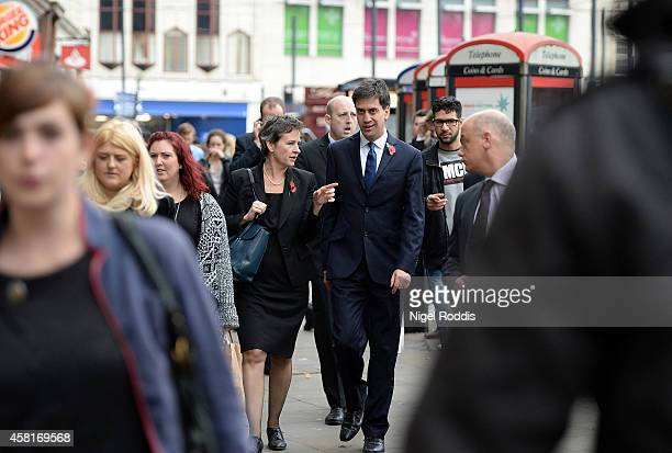 Labour leader Ed Miliband walks with Shadow Transport Secretary Mary Creagh to a meeting with UK council leaders at the Town Hall on October 31 2014...