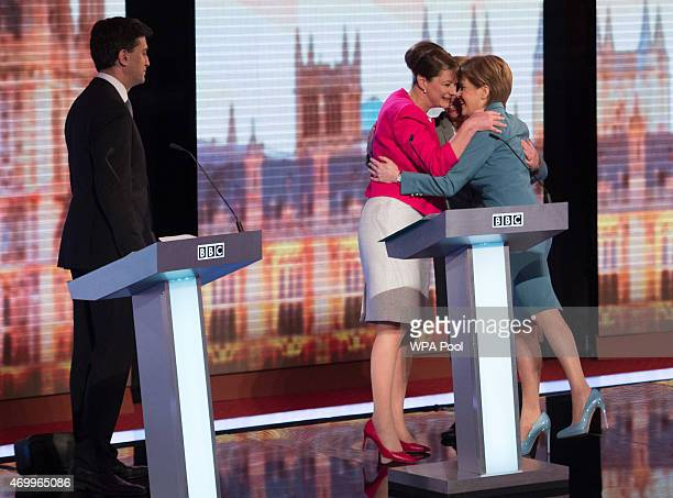 Labour leader Ed Miliband watches as Plaid Cymru leader Leanne Wood Green Party Leader Natalie Bennett and SNP leader Nicola Sturgeon share a hug...