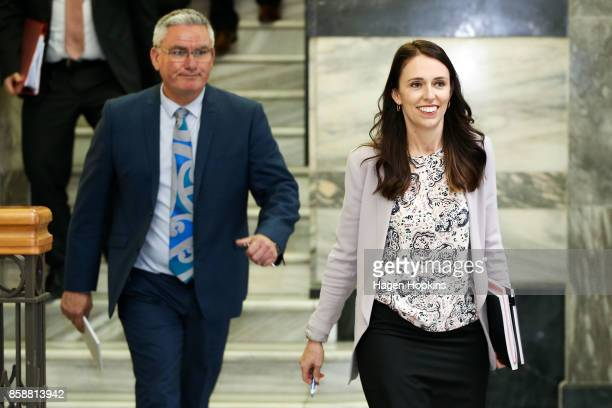 Labour leader Jacinda Ardern and deputy Kelvin Davis make their way to a meeting with NZ First leader Winston Peters at Parliament on October 8, 2017...
