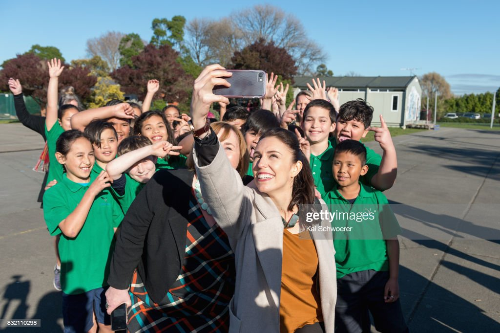 Labour Leader Jacinda Ardern (R) and Labour MP Megan Woods pose with students at Addington Primary School on August 16, 2017 in Christchurch, New Zealand. The Labour party has pledged $10 million towards mental health support for children in Canterbury and Kaikoura to help overcome the trauma of earthquakes, with plans to fund an extra 80 mental health professionals over the next three years who will work in all public primary and intermediate schools.
