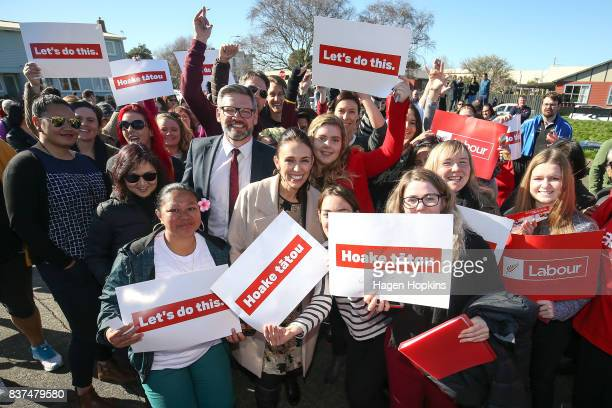 Labour leader Jacinda Ardern and MP for Palmerston North Iain LeesGalloway pose for a photo with suppoeters during a housing announcement at Farnham...
