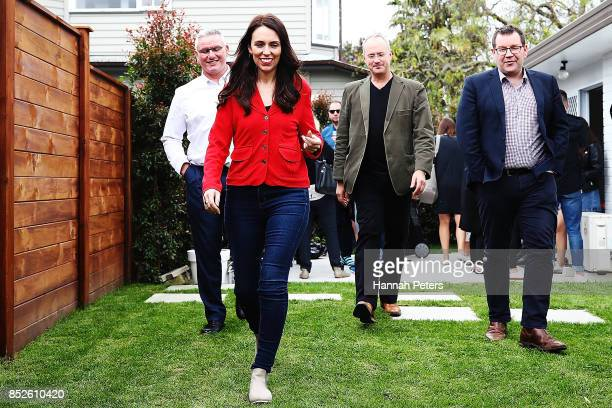 Labour Leader Jacinda Ardern Labour Party MP Phil Twyford Grant Robertson and deputy leader Kelvin Davis arrive to talk to the media during a bbq at...