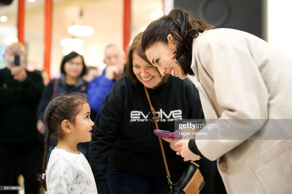 Labour leader Jacinda Ardern meets a young supporter during a visit to The Plaza Shopping Centre on August 23, 2017 in Palmerston North, New Zealand. Ardern announced that Labour will build 149 homes in Palmerston North, a mix of KiwiBuild starter homes for first homebuyers and state houses, to help tackle home affordability and homelessness.