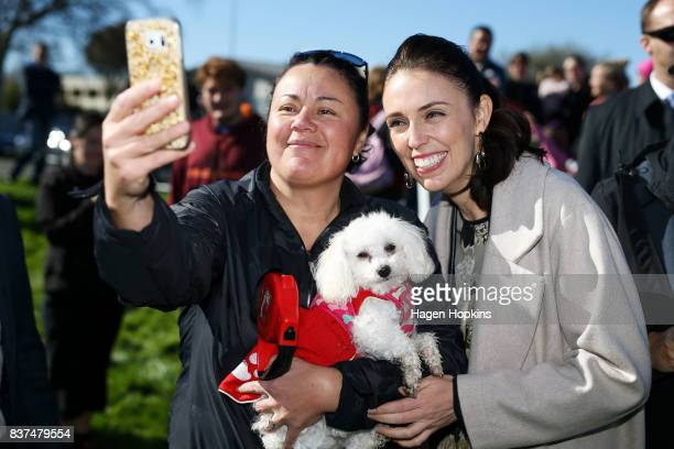 Labour leader Jacinda Ardern poses for a photo with a supporter during a housing announcement at Farnham Park on August 23 2017 in Palmerston North...