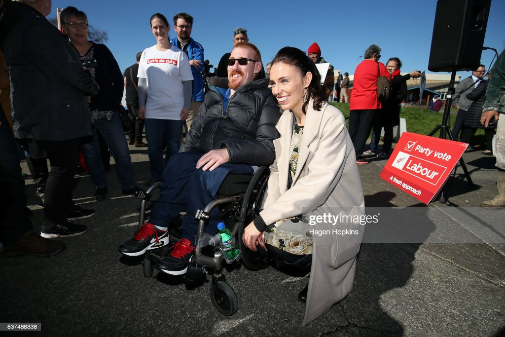 Labour leader Jacinda Ardern poses for a photo with a supporter during a housing announcement at Farnham Park on August 23, 2017 in Palmerston North, New Zealand. Ardern announced that Labour will build 149 homes in Palmerston North, a mix of KiwiBuild starter homes for first homebuyers and state houses, to help tackle home affordability and homelessness.