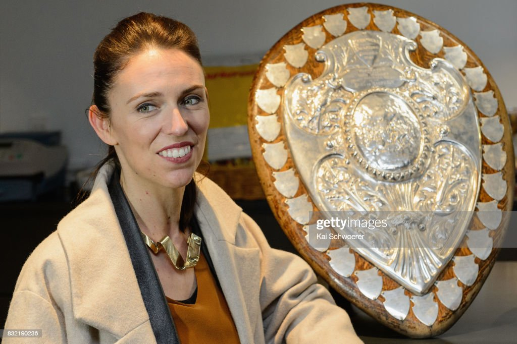 Labour Leader Jacinda Ardern poses with the Ranfurly Shield at Canterbury Rugby on August 16, 2017 in Christchurch, New Zealand. The Labour party has pledged $10 million towards mental health support for children in Canterbury and Kaikoura to help overcome the trauma of earthquakes, with plans to fund an extra 80 mental health professionals over the next three years who will work in all public primary and intermediate schools.