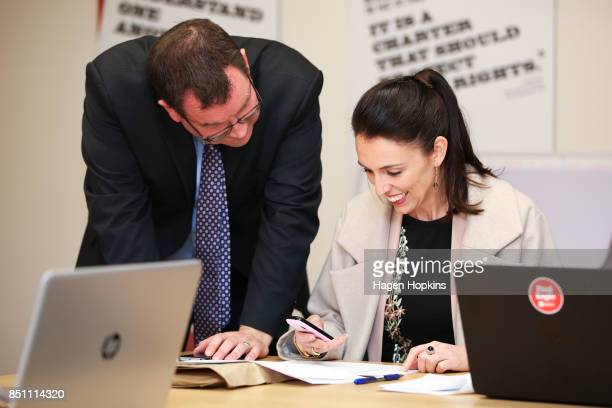 Labour leader Jacinda Ardern prepares to make a campaign call while fellow MP Grant Robertson looks on during a visit to Rongotai candidate Paul...