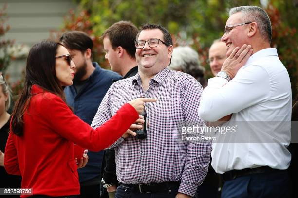 Labour Leader Jacinda Ardern talks with Labour Party MP Grant Robertson and deputy leader Kelvin Davis at her house on September 24 2017 in Auckland...