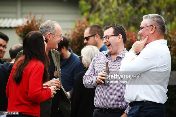 Labour Leader Jacinda Ardern talks with Labour Party MP Phil Twyford Grant Robertson and deputy leader Kelvin Davis at her house on September 24 2017...