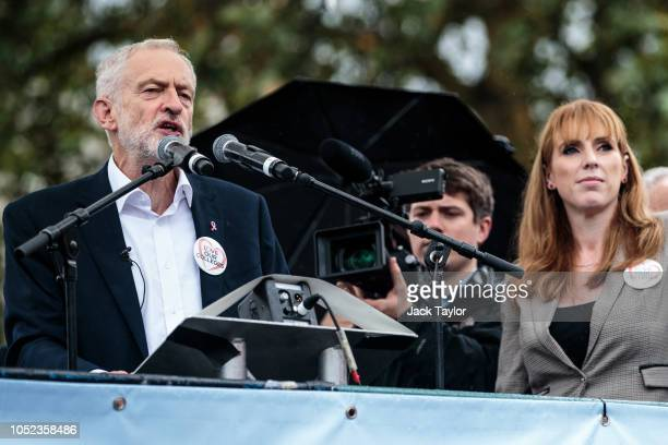 Labour Leader Jeremy Corbyn addresses the crowd beside Shadow Education Minister Angela Rayner MP during a rally by members of the National Education...