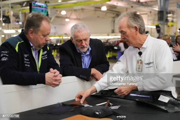 Labour Leader Jeremy Corbyn and Andy Palmer CEO of Aston Martin talk to master trimmer Tom Davies during a visit to luxury car maker Aston Martin on...