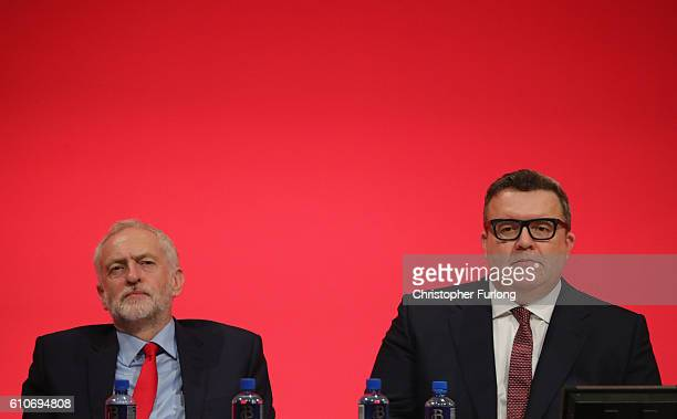 Labour leader Jeremy Corbyn and Deputy leader of the Labour party Tom Watson lisen to a speaker during the third day of the Labour party conference...