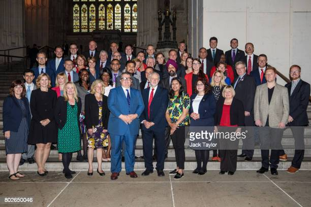 Labour Leader Jeremy Corbyn and Deputy Leader Tom Watson pose with the newly elected Labour MPs in Westminster Hall in the Houses of Parliament on...