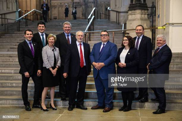 Labour Leader Jeremy Corbyn and Deputy Leader Tom Watson pose with Scottish Labour Party MPs in Westminster Hall in the Houses of Parliament on June...