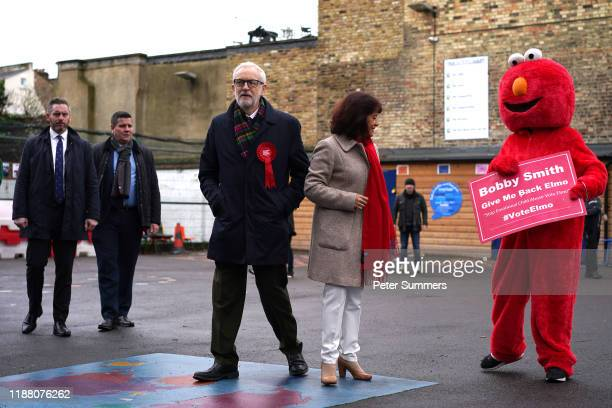 Labour leader Jeremy Corbyn and his wife Laura Alvarez outside the polling station at Pakeman Primary School Holloway on December 12 2019 in London...