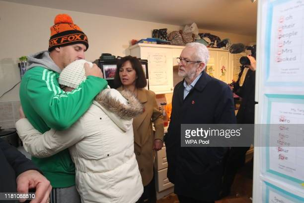 Labour leader Jeremy Corbyn and Labour MP Caroline Flint meet residents James Merritt and Alison Merritt in their house which was affected by...
