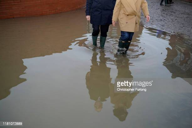 Labour leader Jeremy Corbyn and Labour MP Caroline Flint's reflections are seen as they visit flood hit Conisbrough on November 8 2019 in Doncaster...