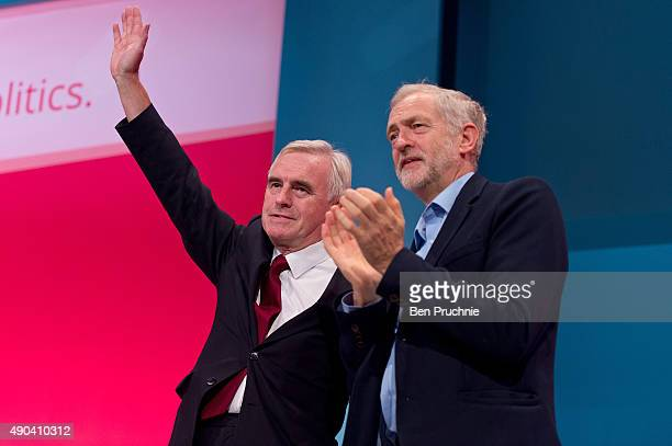 Labour Leader Jeremy Corbyn applaudes Shadow Chancellor John McDonnell after he speaks to delegates in a session entitled Stability and Prosperity...