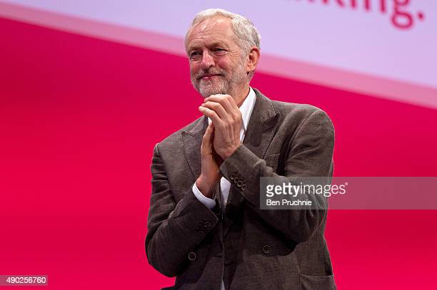 Labour Leader Jeremy Corbyn applauds during a session entitled Rebuilding Our Party during the first day of the Labour Party Autumn Conference on...