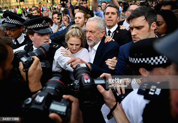 Labour leader Jeremy Corbyn arrives to deliver a speech during Momentum's 'Keep Corbyn' rally outside the Houses of Parliament on June 27 2016 in...