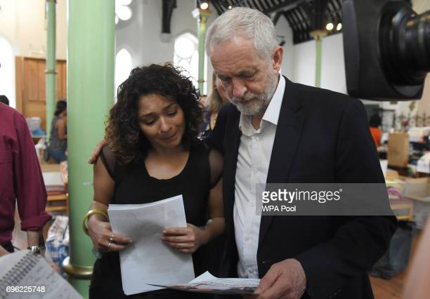 Labour leader Jeremy Corbyn comforts a local resident at St Clement's Church in west London where volunteers have provided shelter and support for...