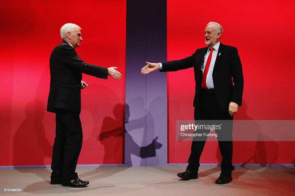 Labour Leader Jeremy Corbyn (R) congratulates Shadow Chancellor John McDonnell (L) after the Shadow Chancellor delivered his keynote speech to the Labour Party Conference on September 26, 2016 in Liverpool, England. During his keynote speech the Labour Shadow Chancellor John McDonnell stated that if in power a Labour government would create a 'manufacturing renaissance'. Labour would also support traditional manufacturing and industry with government 'intervention' if needed. The shadow chancellor also rejected claims that the party is anti-enterprise.