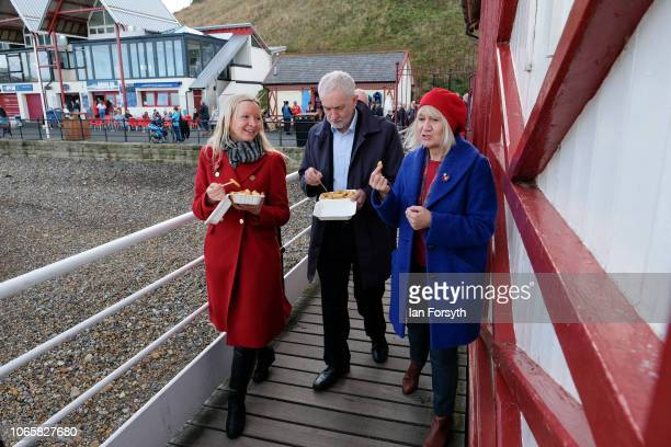Labour leader Jeremy Corbyn eats chips as he walks along Saltburn pier with Lauren Dingsdale Labour's Parliamentary Candidate for Middlesbrough South...
