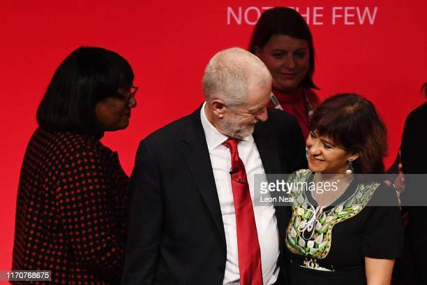 Labour leader Jeremy Corbyn embraces his wife Laura Alvarez following his keynote speech to conference on September 24 2019 in Brighton England After...
